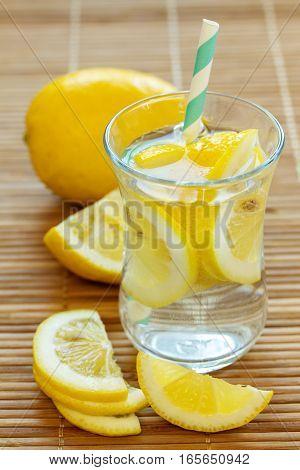 Lemonade with fresh lemon. Lemon water on the table.
