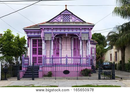 Colorful old house in the Marigny neighborhood in the city of New Orleans Louisiana.