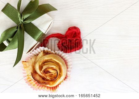 holiday gift with a soft hand knitted heart and Cake in the form flower / set for the day of lovers