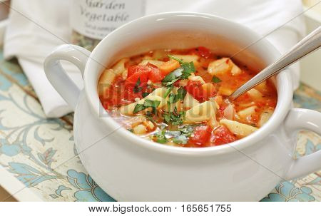 Chicken penne soup flavored with Gainey Vineyard's vegetable seasoning and fresh herbs.