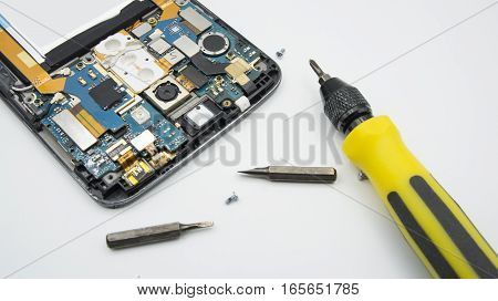 fix damage ic circuit board screwdriver open hand