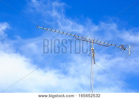 television antenna with a blue sky background.
