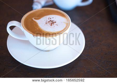 coffee mocha on the wood desk in afternoon break