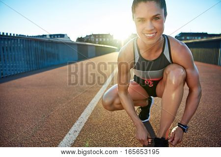 Muscular Woman Smiles At Camera As She Kneels