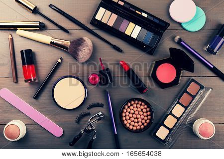 top view of makeup cosmetics set on wooden table