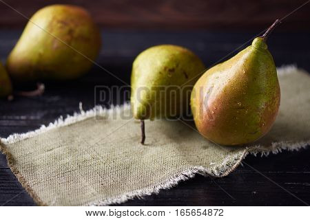 Fresh green pears on a rustic background on a napkin