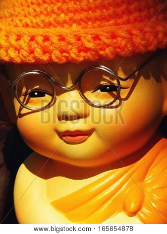 close up of monk doll on sunlight