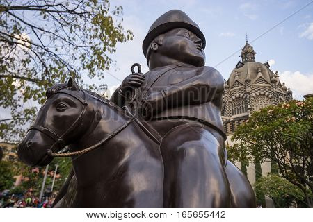 October 19, 2016 MedellinColombia: surrealist statue of a man on horseback donated by Botero to his birth city displayed publicly in the park named after the author