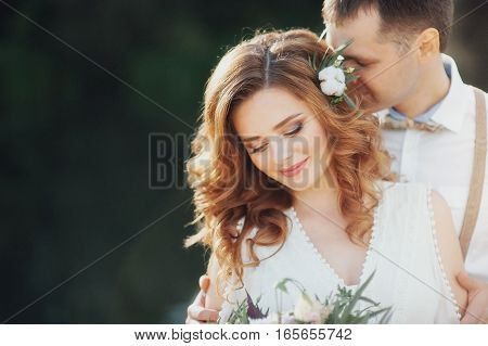 The bride and groom in nature. Rustic Wedding