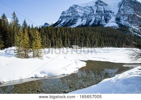River Flowing from Frozen Lake Louise, Banff National Park, Canadian Rockies