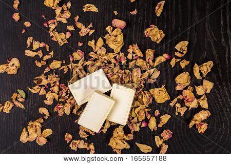 bath soap with dry rose petal closeup. Still life. Copy space