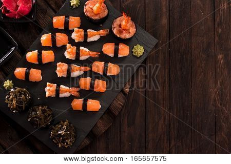 Various Kinds Of Sushi Served On A Platter With Soy Sauce, Wasabi And Pickled Ginger.