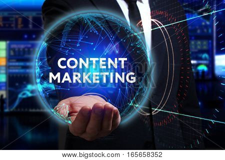 Business Technology Internet and network concept. Young businessman working in the field of the future he sees the inscription: content marketing