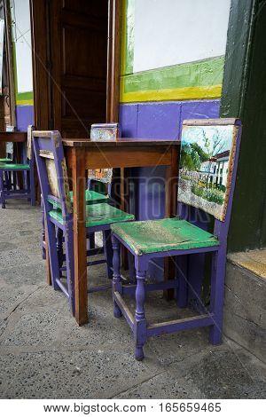 painted cowhide chairs in El Jardin Colombia