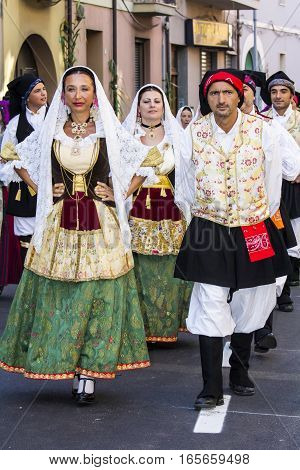 SELARGIUS, ITALY - September 11, 2016: Former marriage Selargino - Sardinia - group of people parading in traditional Sardinian costume