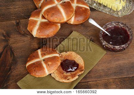 top view hot cross bun with strawberry jam on napkin
