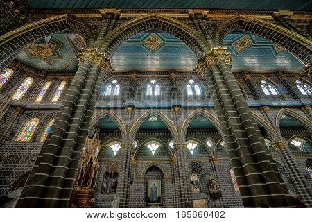 October 1, 2016 El Jardin, Colombia: interior gothic architectural details of the Immaculate Concepcion basilica