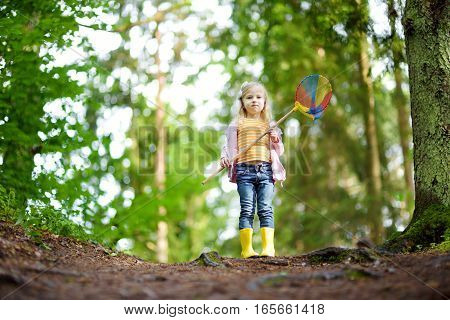 Cute Little Girl Having Fun During Forest Hike
