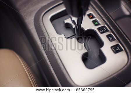 Put a car into neutral. (N) Symbol in auto transmission car. selective focus.
