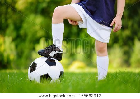 Close-up Of A Child Having Fun Playing A Soccer Game On Sunny Summer Day