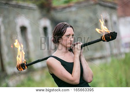 girl with flaming torches Fire show 2