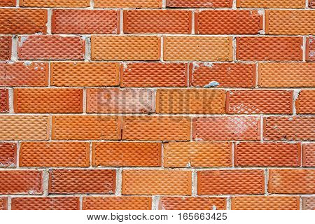 Background of old red and dotted brick wall texture abstract vertical architecture wallpaper