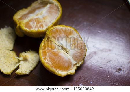 Some orange on a wooden table background.