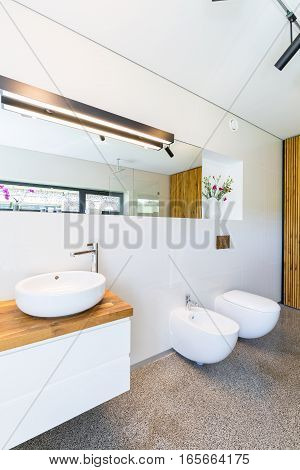 White Bathroom With Wooden Details