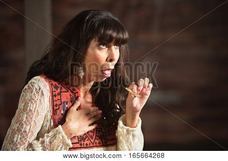 Female Smoker Holding Chest While Coughing