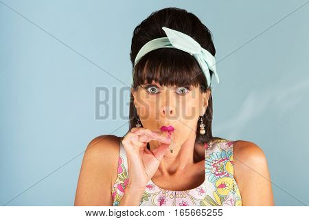 Nervous Woman Smoking A Joint