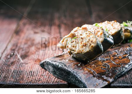 Roasted salmon steaks served on natural board. Closeup view. Selective focus