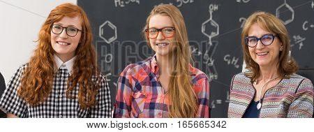 Smiling Professor And Nerdy Students