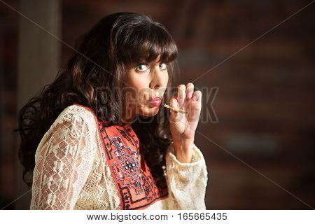Woman With Uneasy Expression Smoking