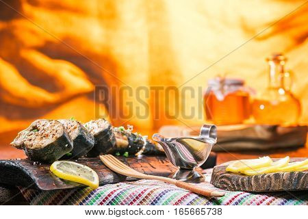 Salmon steaks with condiments on rustic boards. Fire light background
