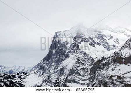 Closeup the peak of the Alps mountains in winter Grindelwald Switzerland.