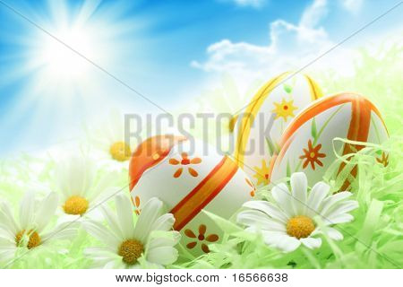Colorful Easter Eggs and Daisy on Green Grass,Shallow Dof.
