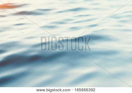 Blue water background with ripples, sea, ocean wave low angle view. Close-up Nature background. Soft focus with selective focus, 3d rendering