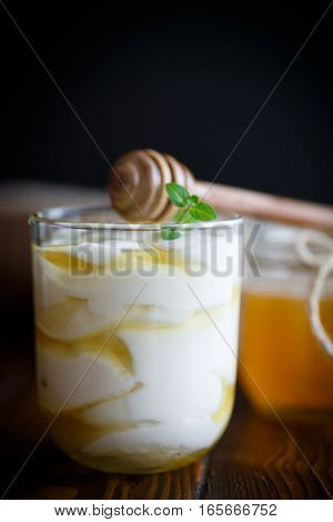 Greek yogurt with honey on a wooden table