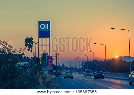 Petrol station and Gas station at sunset with traffic rush on road.