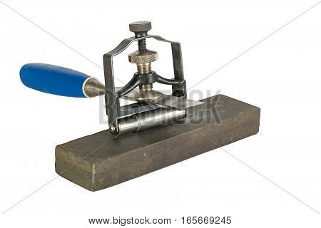 Chisel Clamped In Angle Guide Jigs On Grinding Whetstones