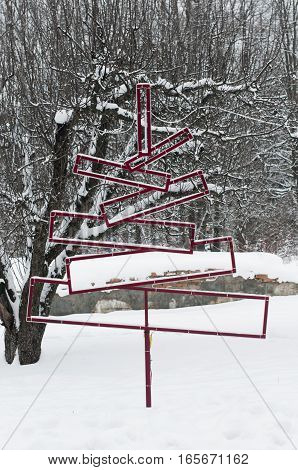 iron Christmas tree installation in the snow