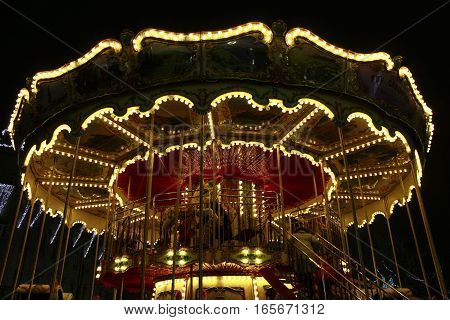 Chernihiv / Ukraine. 01 January 2017: beautiful carousel in the New Year holidays in Chernihiv in the night. 01 January 2017 in Chernihiv / Ukraine.