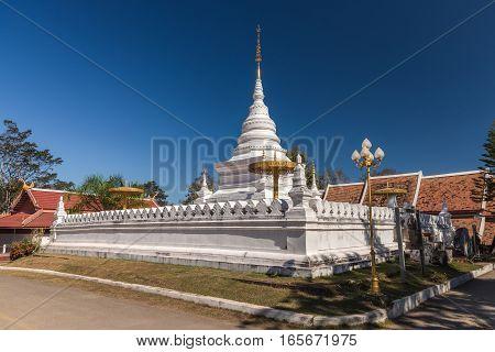 White pagoda of Wat Phra Tat Khao Noi Nan Province Thailand