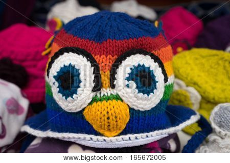 August 2, 2016: closeup hand knitted indigenous hat in the artisan market