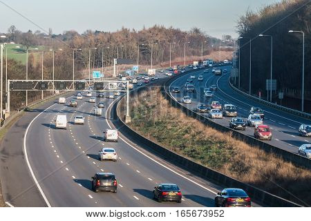 London, UK - January 18, 2017: Busiest British motorway M25 with cars and lorries in a winter sunset time.
