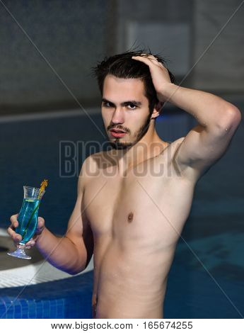 Handsome Muscular Man Drinks Cocktail