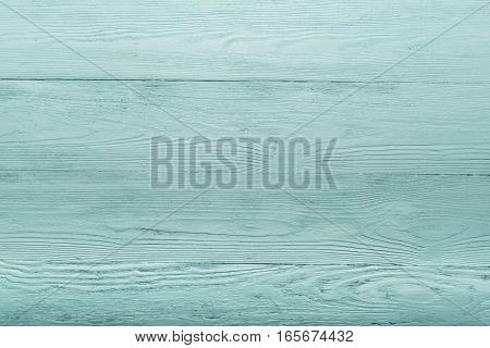 Blue and green wooden bacground. The Emerald table