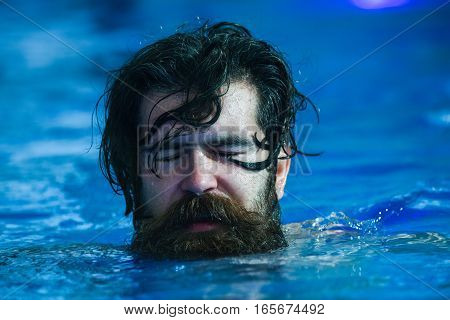 Handsome Man Swims In Pool
