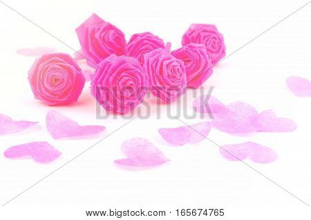 Pink rose fabric flower and small hart on white background for Valentine festival