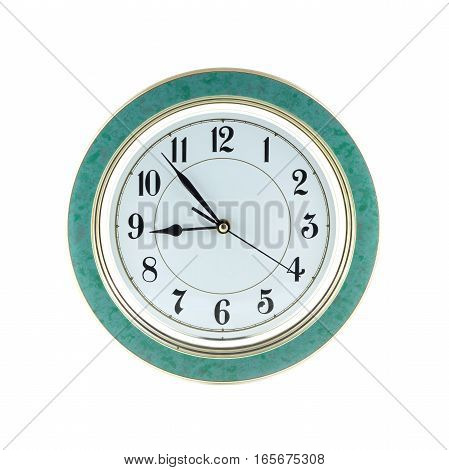Round office wall clock shows almost nine o'clock isolated on white close up